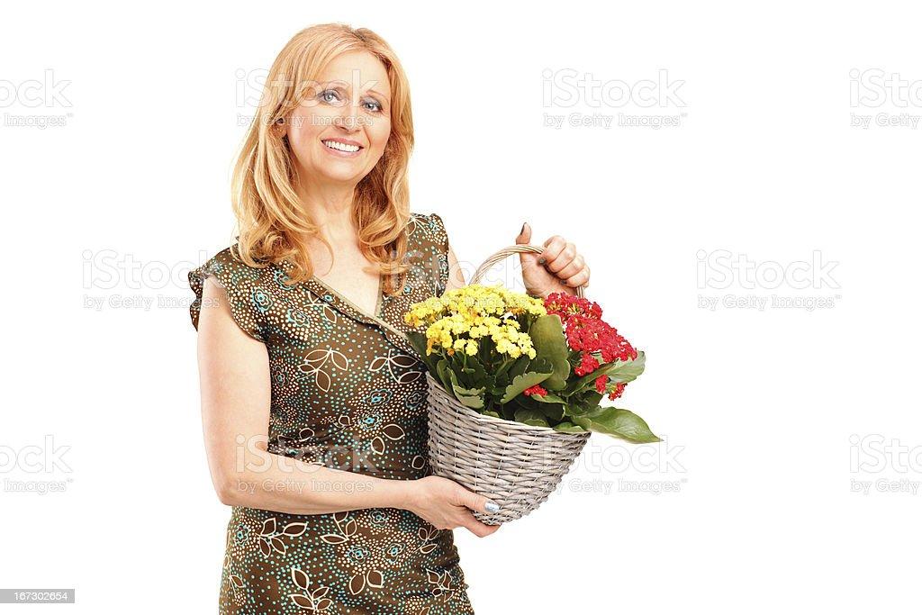 Smiling mature female holding flowers royalty-free stock photo