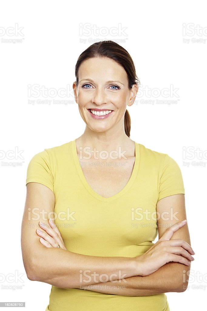 Smiling mature female with arms crossed against white royalty-free stock photo