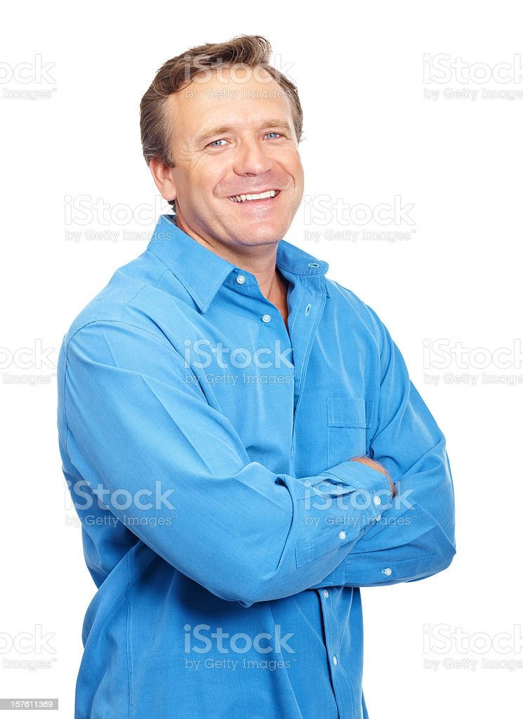 Smiling mature guy standing with arms crossed royalty-free stock photo