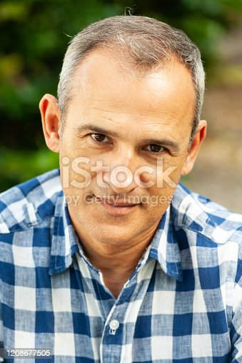 580112984 istock photo Smiling mature hispanic man looking at the camera 1208677505