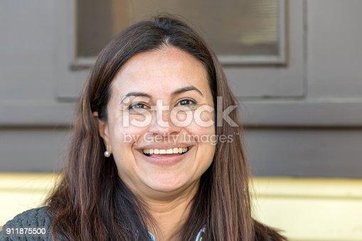 825083310 istock photo Smiling Mature Hispanic Woman 911875500