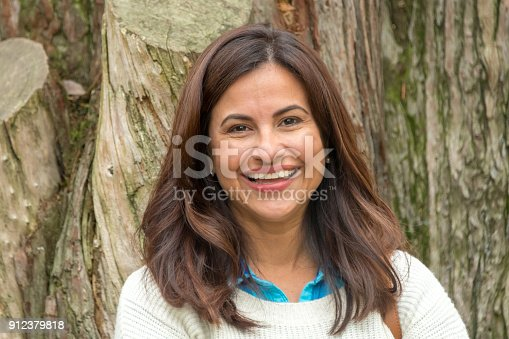 825083310 istock photo Smiling Mature Hispanic Woman 912379818