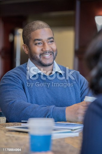 istock Smiling mature male professional in business meeting in conference room 1179884994