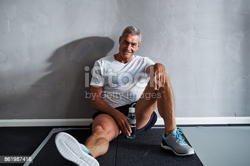 istock Smiling mature man taking a break after working out 861987416