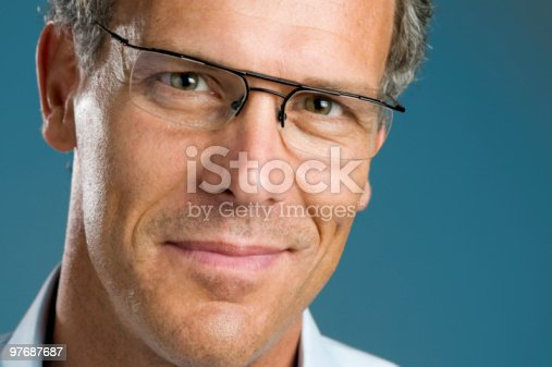 825083248istockphoto Smiling mature man with glasses 97687687