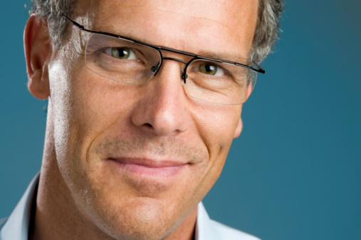825083248 istock photo Smiling mature man with glasses 97687687