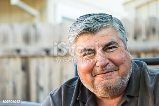 istock Smiling mature senior man 809704042