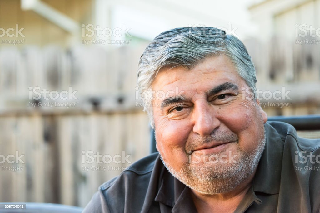 Smiling mature senior man stock photo