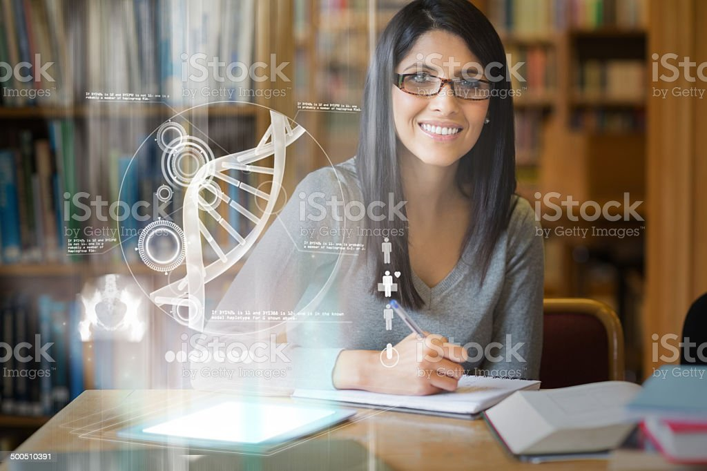 Smiling mature student studying medicine on digital interface stock photo