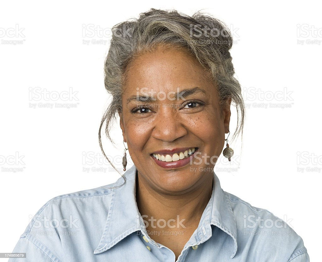 Smiling Mature Woman Head And Shoulders Portrait stock photo