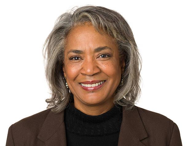 smiling mature woman headshot portrait - mature women studio grey hair bildbanksfoton och bilder
