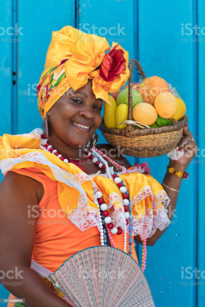 Smiling mature woman in Cuban traditional costume stock photo