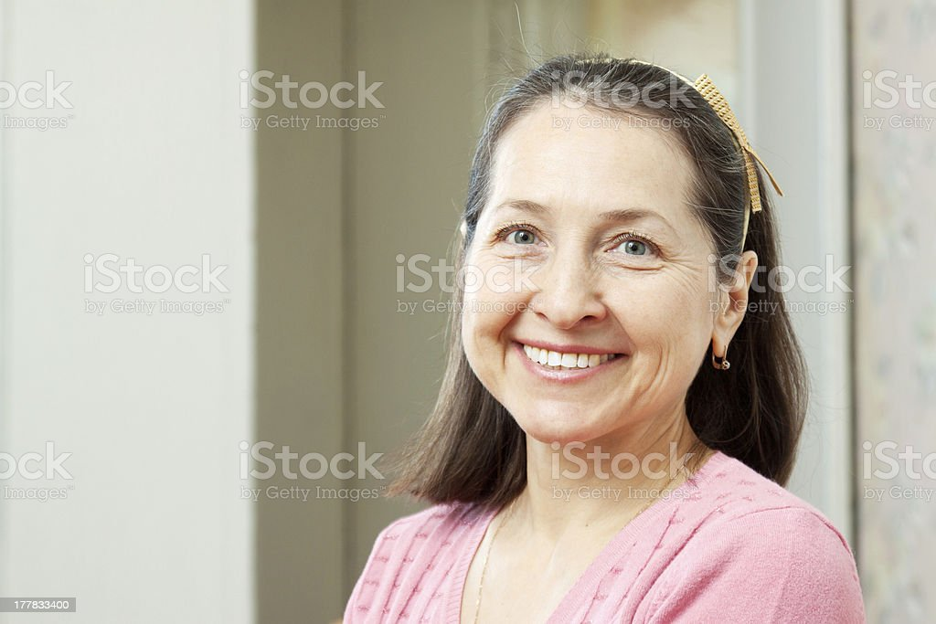 smiling mature woman in home i stock photo