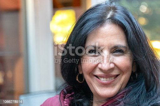 825083310 istock photo Smiling mature woman looking at the camera 1066278514