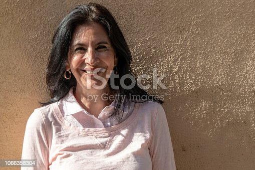 825083310 istock photo Smiling mature woman looking at the camera 1066358304