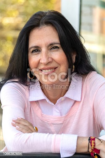 825083310 istock photo Smiling mature woman looking at the camera 1066382654
