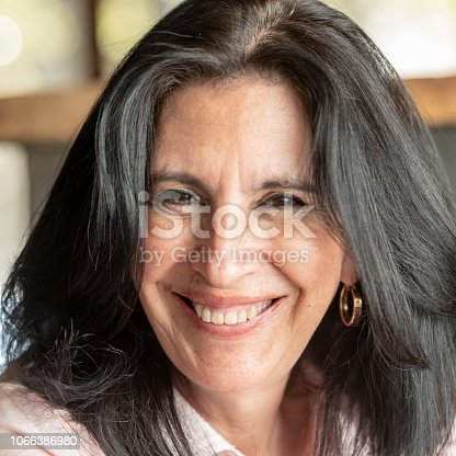 825083310 istock photo Smiling mature woman looking at the camera 1066386980