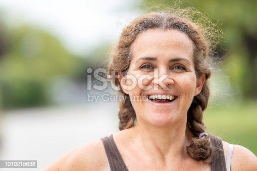 825083310 istock photo Smiling mature woman 1010215638