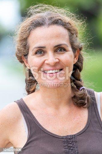 825083310 istock photo Smiling mature woman 1010221606