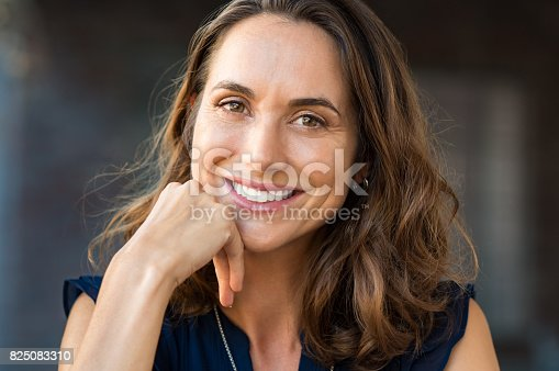 istock Smiling mature woman 825083310