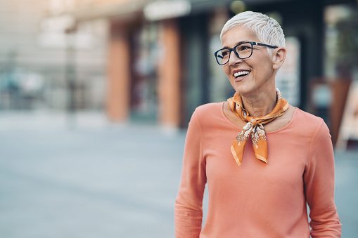 Senior woman outdoors in the city
