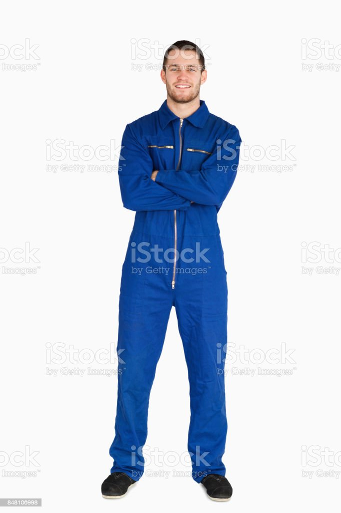 Smiling mechanic in boiler suit stock photo