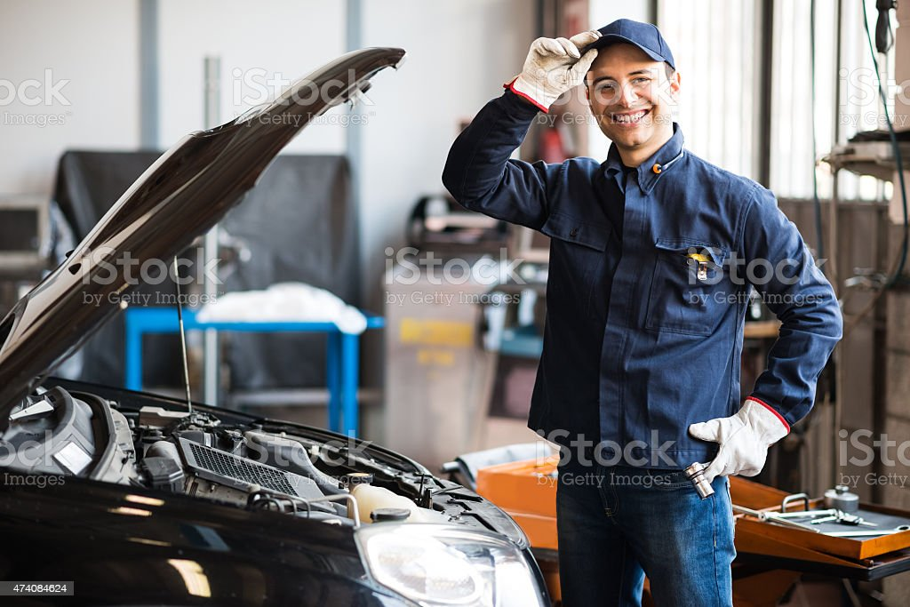 Smiling mechanic stock photo