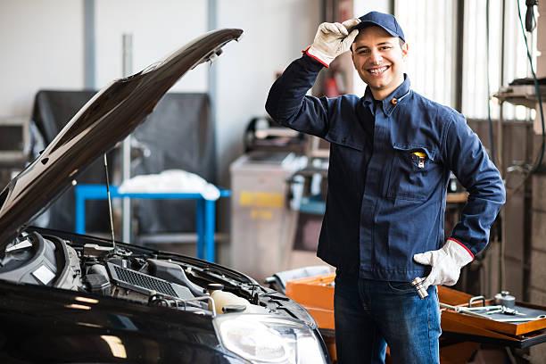 Smiling mechanic stock photo