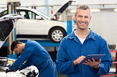 istock A smiling mechanic using a tablet PC 468986130
