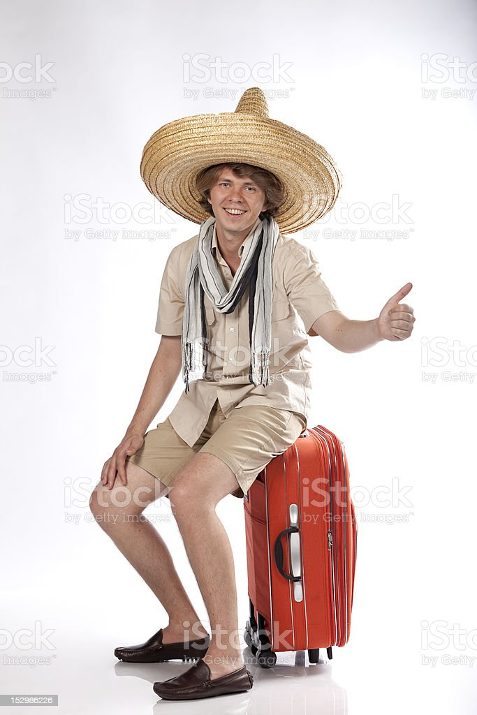 Smiling mexican man hitchhiking royalty-free stock photo