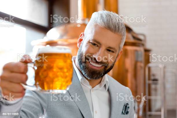 Smiling Microbrewery Owner Holding A Beer Mug In His Pub Stock Photo - Download Image Now