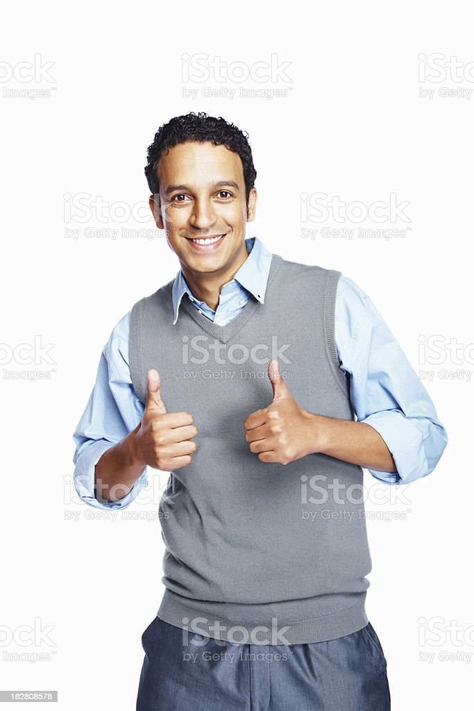 Smiling mid adult businessman showing thumbs up sign royalty-free stock photo