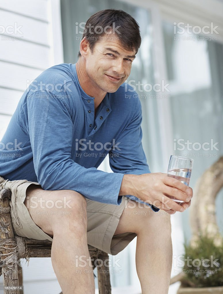 Smiling mid adult guy with a glass of water Portrait of a smiling mid adult guy with a glass of waterMore Images: 30-39 Years Stock Photo