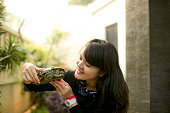 asian young Woman Holding Turtle