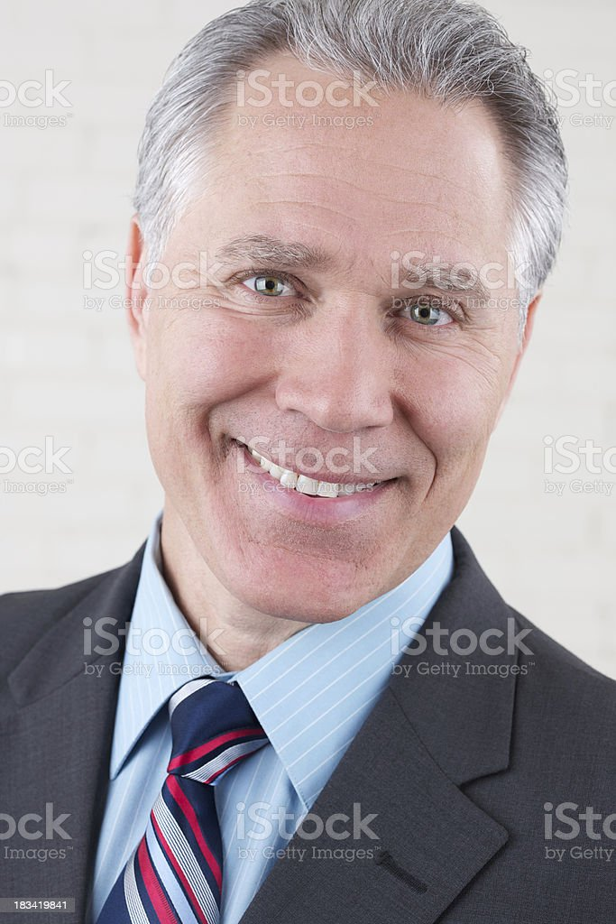 Smiling middle age man with dark suit and tie royalty-free stock photo