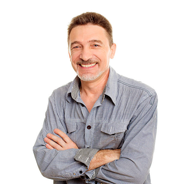 Smiling middle age man with grey shirt stock photo