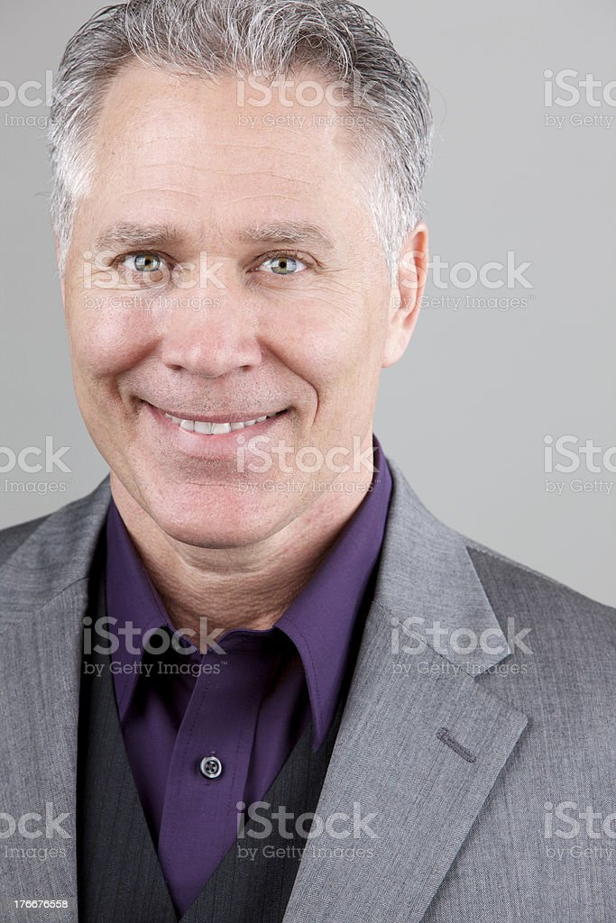 Smiling middle age man with light grey suit royalty-free stock photo