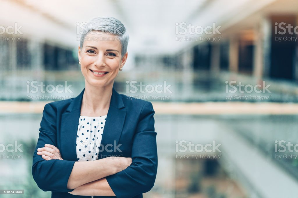 Smiling middle aged businesswoman stock photo