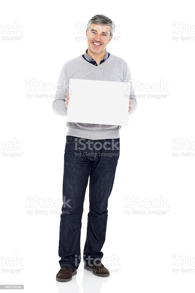 Smiling middle aged guy holding a blank billboard royalty-free stock photo