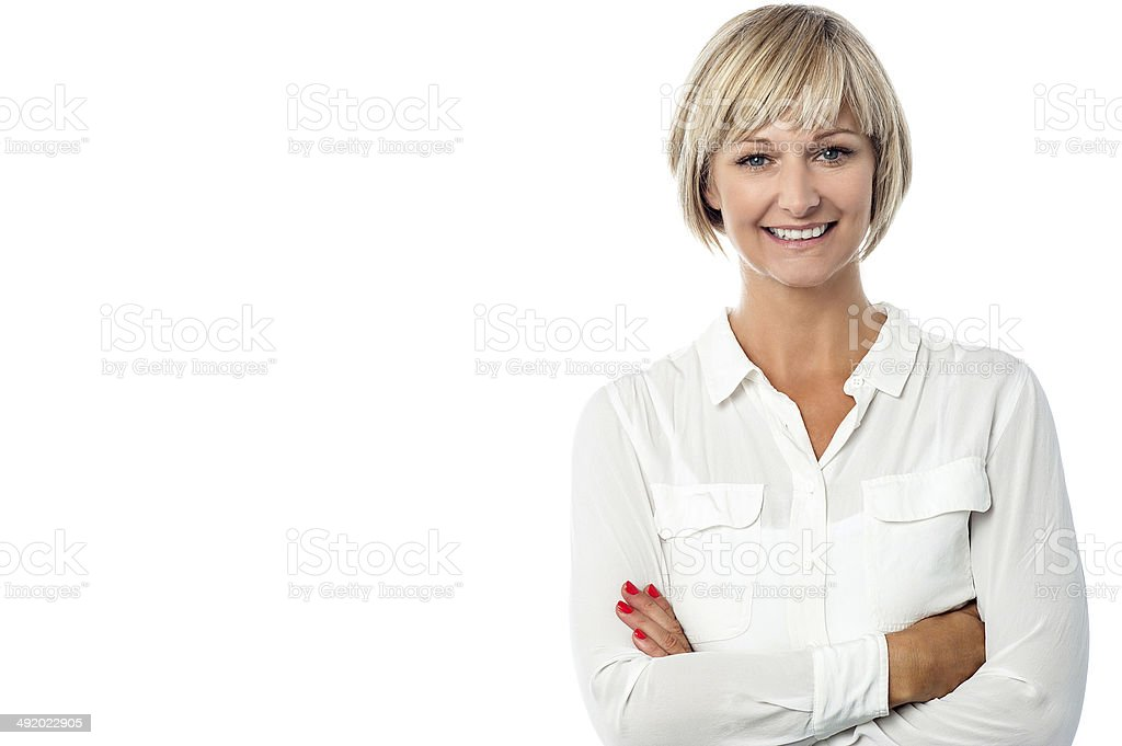 Smiling middle aged lady, arms crossed. royalty-free stock photo