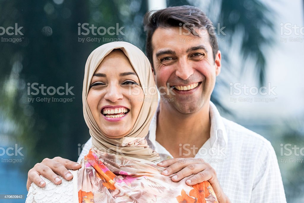 Smiling middle eastern couple stock photo