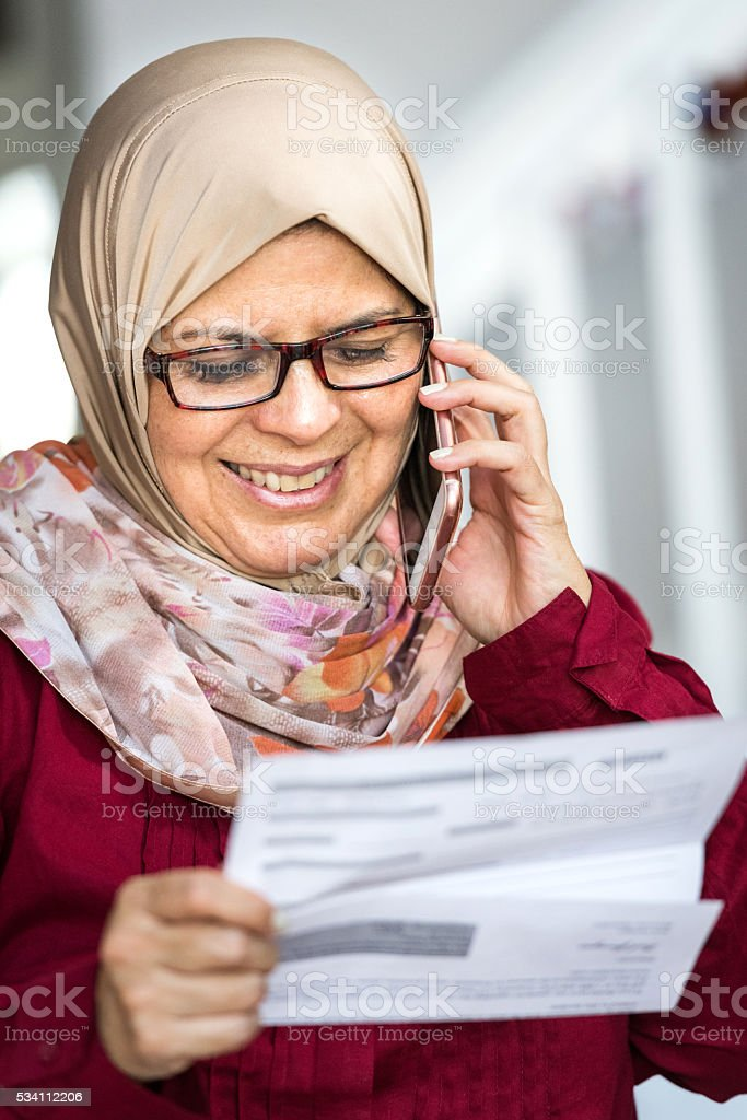 Smiling middle eastern woman stock photo