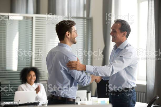 Smiling middleaged ceo handshaking successful male worker showing picture id1070271624?b=1&k=6&m=1070271624&s=612x612&h=bl5misgrjni9rmwz6w272li066d8woczd8lydki3t9s=