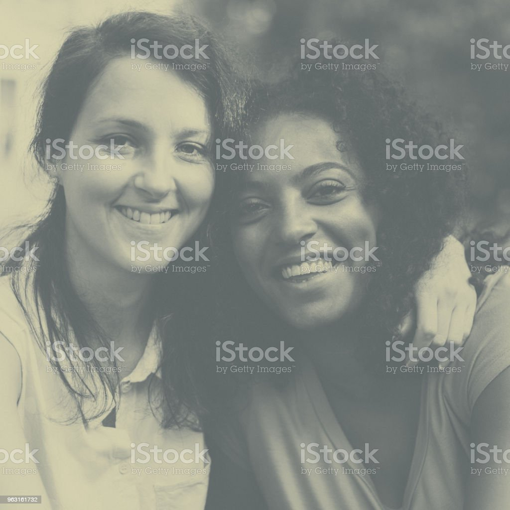 Smiling mixed race girls together stock photo