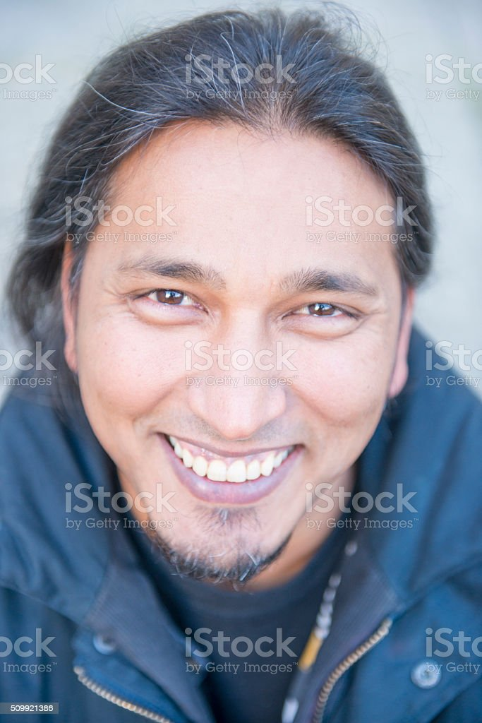 Smiling mixed race man looking to camera royalty-free stock photo