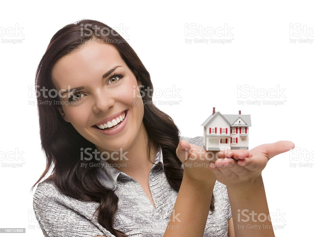 Smiling Mixed Race Woman Holding Small House Isolated on White royalty-free stock photo