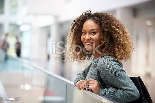 istock Smiling mixed race young woman looking to camera 597958710