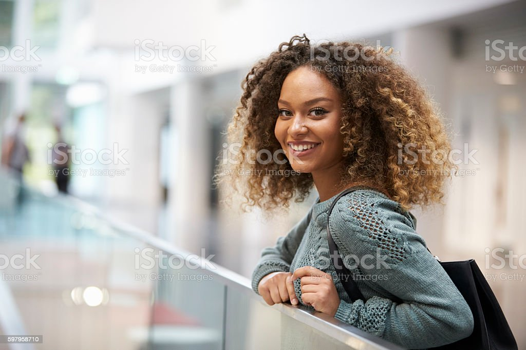 Smiling mixed race young woman looking to camera - foto stock