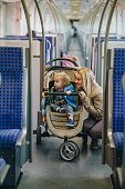 Smiling mother and her small son traveling by train.