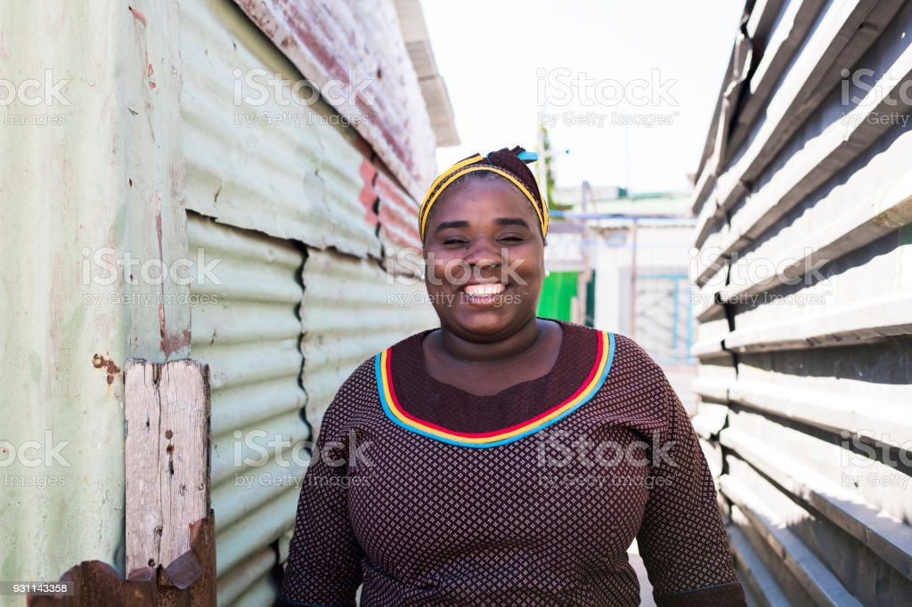 Smiling mother standing outdoors stock photo